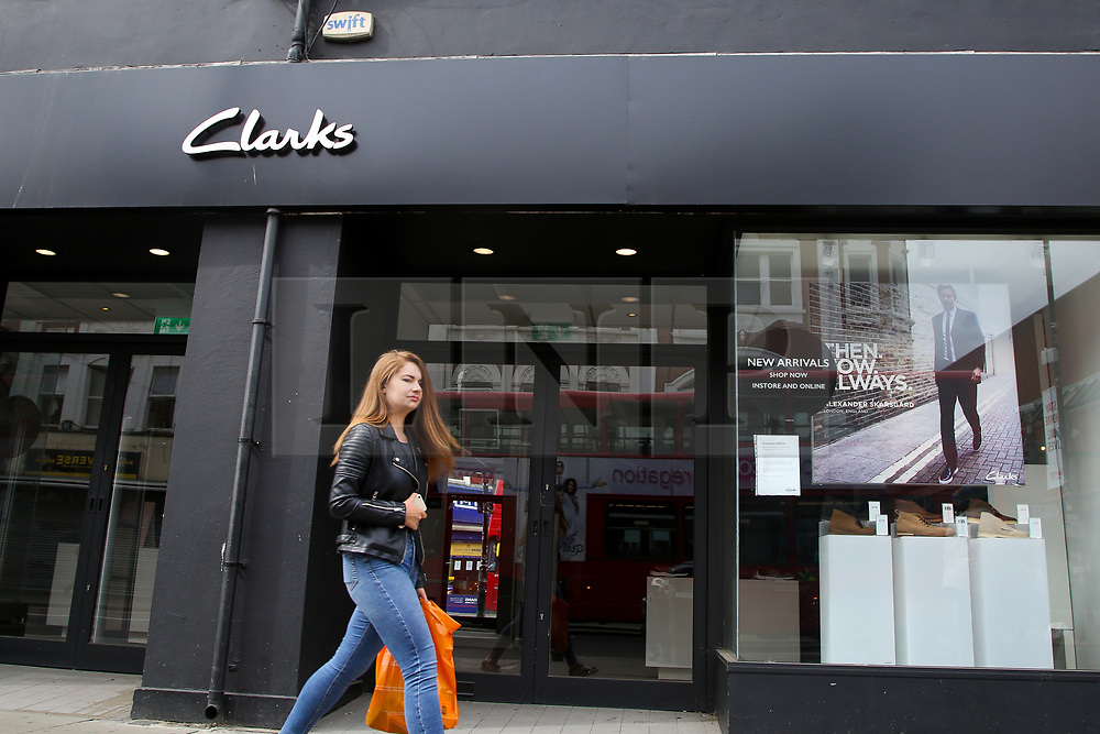 © Licensed to London News Pictures. 22/05/2020. London, UK. A woman walks past a branch of Clarks, UK shoe retailer, in Wood Green, north London. The company announced that it is to lose 900 jobs as it adapts to the challenges posed by the coronavirus crisis. Photo credit: Dinendra Haria/LNP