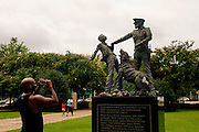 A statue by Ronal McDowell dedicated to the foot soldiers of the Civil Rights Movement stands in Kelly Ingram Park in downtown Birmingham August 13, 2013. The park has several art installations that coincide with the Birmingham Civil Rights Institute and the 16th Street Baptist Church, which sit across the street.