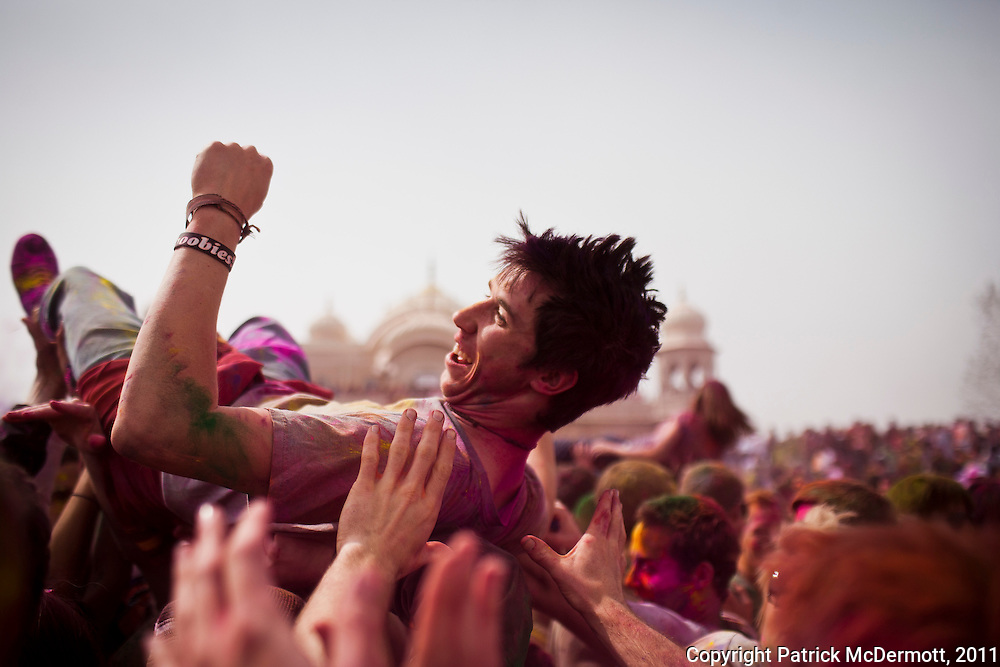 Both Hindu devotees and non-Hindus play with colored powders during Holi celebrations at the Sri Sri Radha Krishna Temple on March 27, 2011 in Spanish Fork, Utah. Holi, the spring festival of colours, is celebrated by Hindus around the world in an explosion of color to mark the end of the winter.