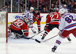 February 1, 2008; Newark, NJ, USA;  New Jersey Devils goalie Martin Brodeur (30) makes a save as New Jersey Devils defenseman Colin White (5) plays defense on New York Rangers center Brandon Dubinsky (17) during the first period at the Prudential Center in Newark, NJ.