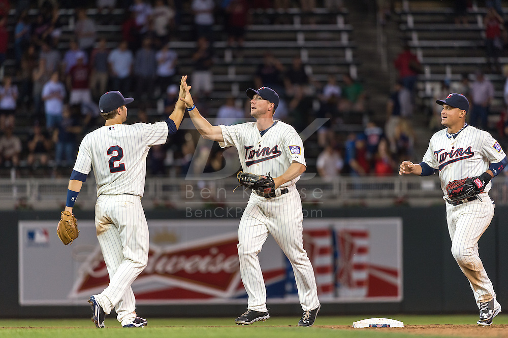 Clete Thomas #11 and Brian Dozier #2 of the Minnesota Twins celebrate after the Twins defeated the Chicago White Sox on June 19, 2013 at Target Field in Minneapolis, Minnesota.  The Twins defeated the White Sox 7 to 4.  Photo: Ben Krause