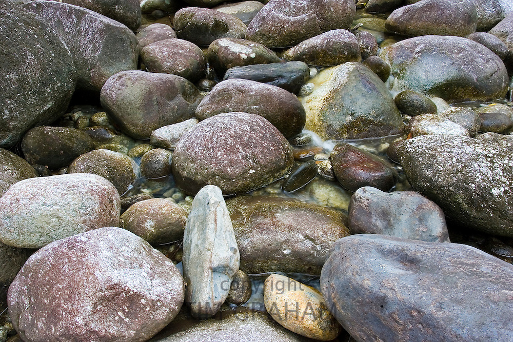 Stones and boulders on the Mossman riverbed, Daintree Rainforest, Queensland, Australia