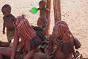 Himba women sell handicraft and knickknacks to tourists to their village, Kaokoveld, Namibia, Africa