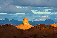 I waited for the perfect light to photograph the different layers of sandstone buttes at sunset in the Southwest.