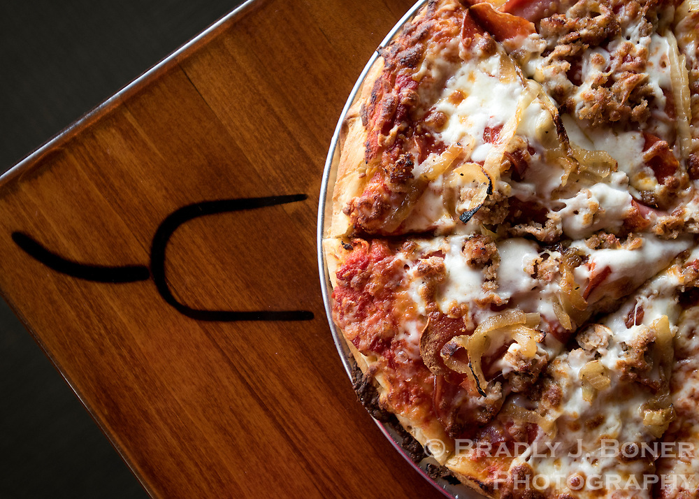 The Thor Peak pizza at Dornan's includes sausage, pepperoni, Canadian bacon and caramelized onions.
