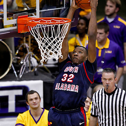 November 23, 2011; Baton Rouge, LA; South Alabama Jaguars forward Javier Carter (32) dunks against the LSU Tigers during the second half of a game at the Pete Maravich Assembly Center. South Alabama defeated LSU in overtime 79-75. Mandatory Credit: Derick E. Hingle-US PRESSWIRE