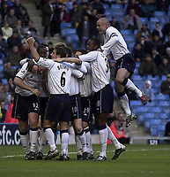 Photo. Glyn Thomas.<br /> Manchester City v Tottenham Hotspur. FA Cup fourth round. <br /> City of Manchester Stadium, Manchester. 25/01/2004.<br /> Spurs' Stephen Carr (R) leaps in delight as Gary Doherty is mobbed by teammates after putting his side level.