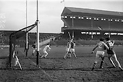 26/02/1967<br /> 02/26/1967<br /> 26 February 1967<br /> Railway Cup Semi-Finals: Ulster v Munster at Croke Park, Dublin.<br /> J. Kirk, the Ulster goalie, dives out to stop a flying ball from Munster's B. Hartigan, but the ball flashed past to put Munster's score up a goal at 4 goals 6 points against Ulster's 0 goals and 2 points. Also to clinch the score were J. McKenna and T. Bluett.