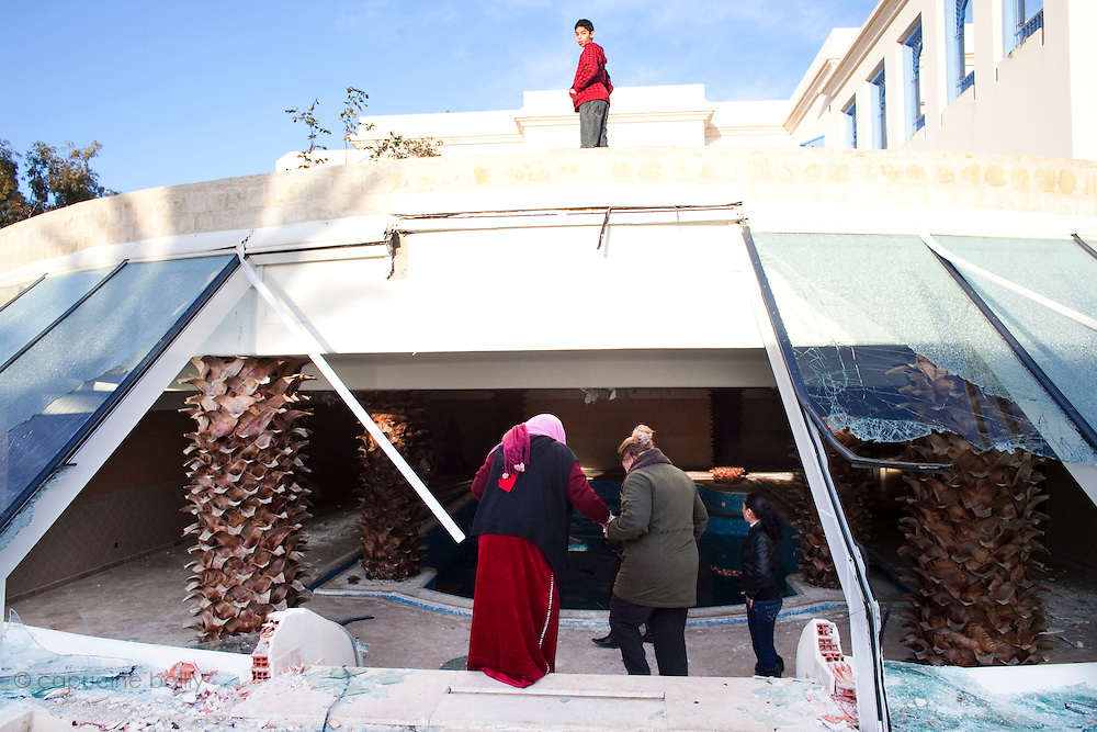 Gammarth, Tunisia. January 29th 2011.The destroyed house of Belhassen Trabelsi who is Leila Trabelsi's older brother..People walked around the house with family and friends.....