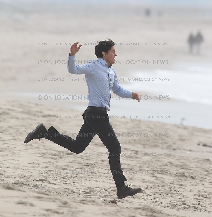 """February 4th, 2009 Venice Beach, California. Orlando Bloom on the set of """"The Good Doctor"""". Orlando brought his dogs to the set and spent time with them during filming breaks. Orlando's scenes included him running at full speed from the beach into the ocean and then being overtaken by the waves. Bloom seemed very tired by the end of the day from all the running and ocean work. Photo by Eric Ford/ On Location News 818-613-3955 info@onlocationnews.com"""