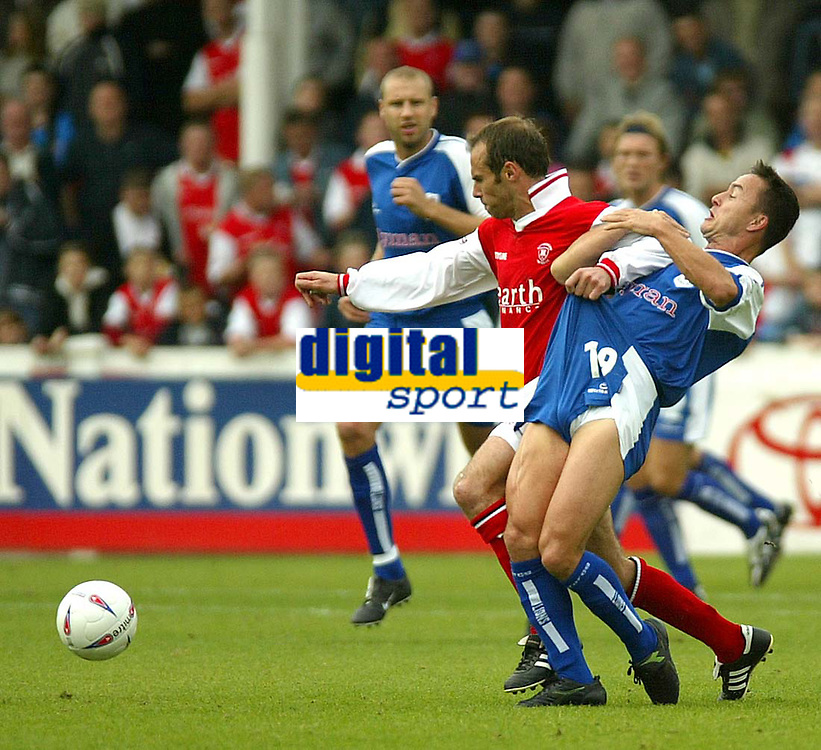 Photo. Andrew Unwin<br /> Rotherham v Millwall, Nationwide League Division One, Millmoor Lane, Rotherham 11/10/2003.<br /> Millwall's Dennis Wise (r) battles with Rotherham's Paul Warne (l).