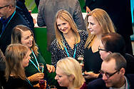 Event Photography images from Tivoli Congress Center in Copenhagen. The client was Basware, based in Finland.  <br /> <br /> Delegates socialising in the middle of a crowded room.  <br /> <br /> © Event Photographer in Copenhagen Matthew James