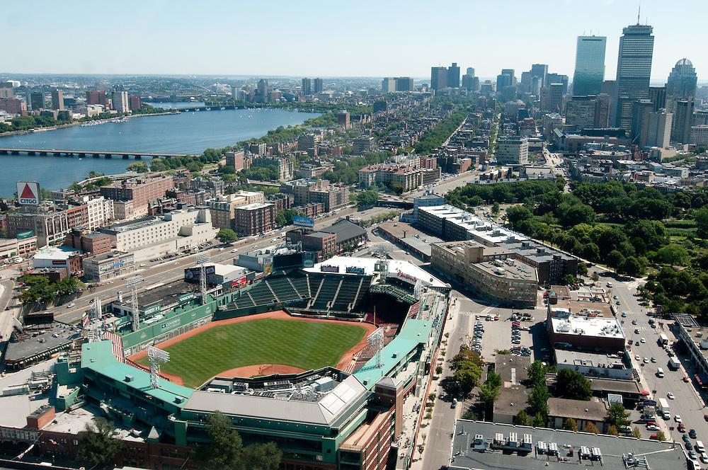 East facing aerial view of Boston's Fenway Park from Flight Centre helicopter with downtown Boston on the right and the Charles River on the left.