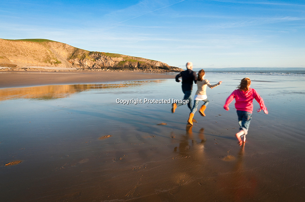 Father and two daughters<br /> Dunraven Bay (looking West - early evening)<br /> Southerndown<br /> Heritage Coast<br /> Vale Of Glamorgan<br /> South<br /> Walking<br /> Activities &amp; Sports