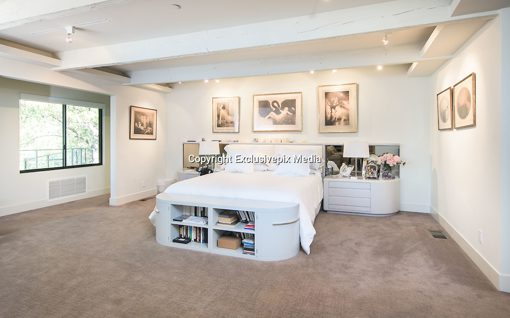 "EXCLUSIVE - Jane Fonda home – splits with boyfriend and home - mansion on the market for US$13 million<br /> <br /> OFFICIALLY AUTHORIZED HIGHRES PHOTOS <br /> <br /> It was love at first sight, twice. The first, when actress Jane Fonda met music producer Richard Perry while in hospital recovering from knee surgery in 2009. The second, when the couple took a look at this modernist mansion in Beverly Hills a few years later.<br /> <br /> She knew immediately it was the house for her and her partner, but now, five years later, after their break-up was announced on Monday [Jan 24, 2017], it is time to say goodbye to the 660 sq.m home.<br /> <br /> ""I took one look at this house and I knew, I just knew,"" recalls Fonda, ""This was a place where we could live very happily.""<br /> <br /> She was attracted to the strong architectural lines, the shining stainless steel front door, and the many windows with their stunning canyon and views. <br /> <br /> ""The house inspires me to be comfortable and have a great time,"" she says, happily recalling celebrating her 75th birthday with 150 guests in the home.<br /> <br /> The two-story, four bedroom home was built in 1961 but has been remodelled with a number of environmentally friendly features: bamboo floors, solar heating, bio-ethanol fireplaces and thermal glass double-glazed UV windows.<br /> <br /> But just an enticing to the 79-year-old environmentalist was the master bedroom with its dual master baths and walk-in closets. ""This is the first time in my 79 years that I have had a closet that you could walk in and see everything that you have,"" she says.<br /> <br /> Other features in the home include a glass lift, a media room and a gym.<br /> <br /> Outdoors, and spread over 1/3 hectare, the property features a solar heated pool, a deck extending over the steep hillside, a secluded meditation garden with a fountain, and a fire pit ""where you can see the sun set.""<br /> <br /> The ex-couple decorated their home with the trapping of their success. An Oscar from Jane, gold records from Richard and Andy Warhol portraits of Jane.<br /> <br /> According"