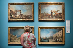 © Licensed to London News Pictures. 28/06/2018. LONDON, UK. A visitor views works by Francesco Guardi and Canaletto Members of the public visit Masterpiece London, the world's leading cross-collecting art fair held in the grounds of the Royal Hospital Chelsea.  The fair brings together 160 international exhibitors presenting works from antiquity to the present day and runs 28 June to 4 July 2018.  Photo credit: Stephen Chung/LNP