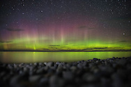 The Aurora Borealis makes a brief but dazzling appearance over Lake Superior.<br />