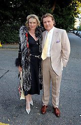 THEO & LOUISE FENNELL at Sir David & Lady Carina Frost's annual summer party held in Carlyle Square, London on 6th July 2004.