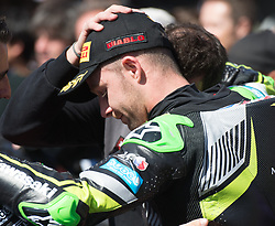 February 25, 2018 - Melbourne, Victoria, Australia - British rider Jonathan Rea (#1) of Kawasaki Racing Team is consoled by his team after finishing in second place in the second race on day 3 of the opening round of the 2018 World Superbike season at the Phillip Island circuit in Phillip Island, Australia. (Credit Image: © Theo Karanikos via ZUMA Wire)