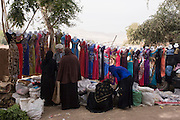 Colourful dress designs on a stall at the weekly market at Qurna, a village on the West Bank of Luxor, Nile Valley, Egypt.