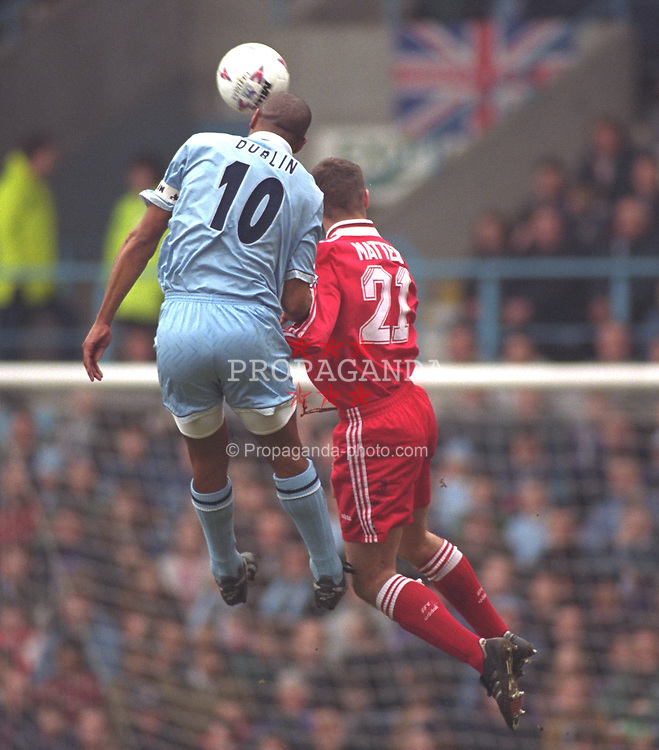 COVENTRY, ENGLAND - Saturday, April 6, 1996: Liverpool's Dominic Matteo in action against Coventry City's Dion Dublin during the Premiership match at Highfield Road. Coventry won 1-0. (Pic by David Rawcliffe/Propaganda)
