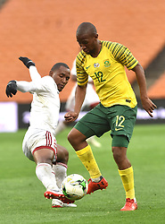 South Africa: Johannesburg: Bafana Bafana player Kamohelo Mokotjo battle for the ball with Seychelles player Colin Bibi during the Africa Cup Of Nations qualifiers at FNB stadium, Gauteng.<br />