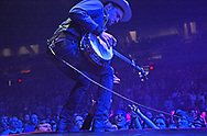 A member of the Avett Brothers plays to the audience at the DCU Center. Chris Christo photo
