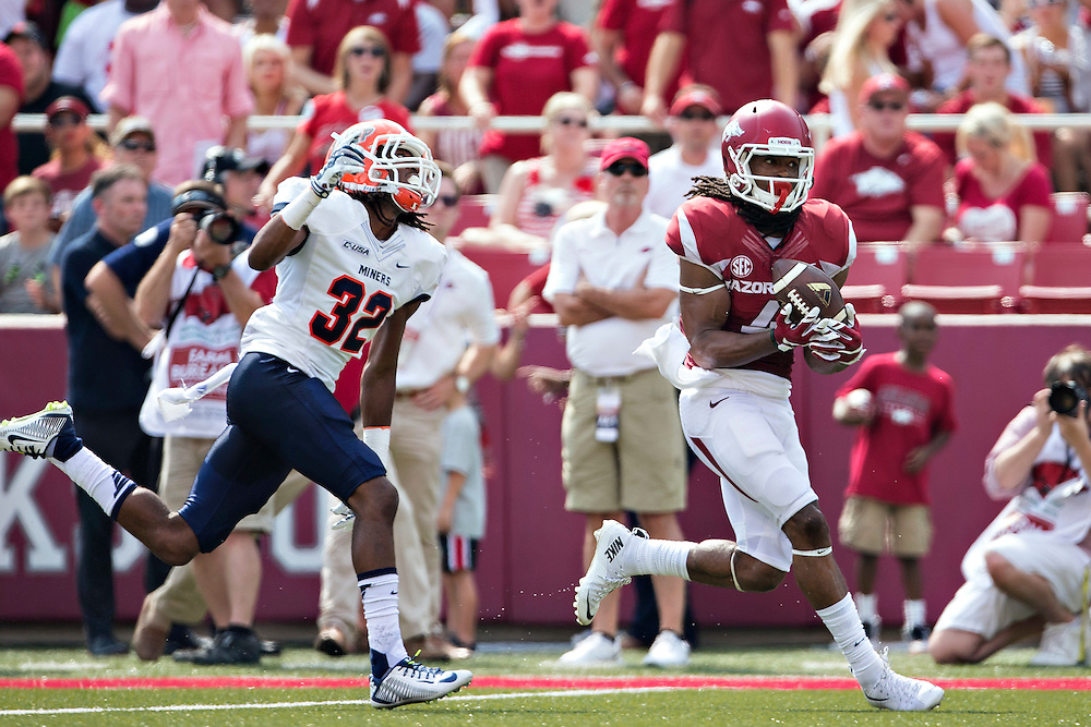 FAYETTEVILLE, AR - SEPTEMBER 5:  Keon Harcher #4 of the Arkansas Razorbacks catches a touchdown pass over Kalon Beverly #32 of the UTEP Miners at Razorback Stadium on September 5, 2015 in Fayetteville, Arkansas.  (Photo by Wesley Hitt/Getty Images) *** Local Caption *** Keon Hatcher; Kalon Beverly