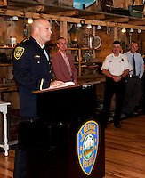 Laconia's Chief of Police Christopher A. Adams addresses the crowd with Commissioner Armand Maheux and retired Chief Michael Moyer looking on following his swearing in ceremony at The Freight Room Tuesday afternoon.  (Karen Bobotas/for the Laconia Daily Sun)