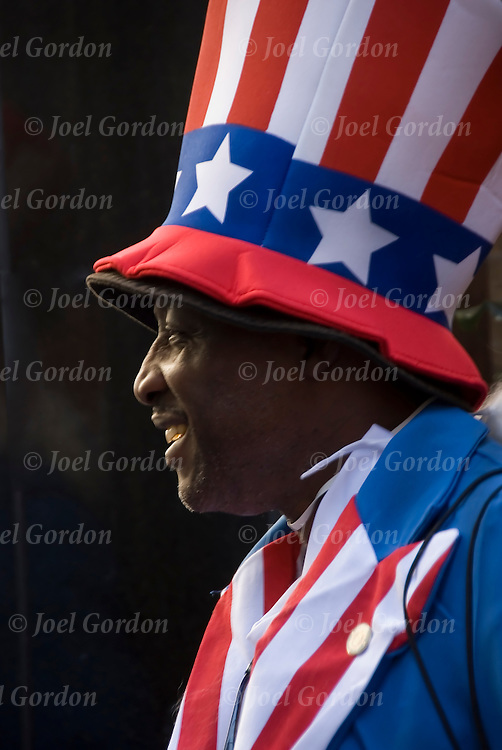 African American war veteran wearing Uncle Sam costume in lower Manhattan on 9/11/2010 selling American Flags for $5 and $3 and cold water for $1 on street corner.