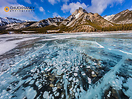 Mt Abraham at sunrise and methane ice bubbles under clear ice on Abraham Lake near Nordegg, Alberta, Canada