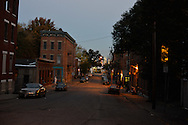 "Storrs Street, the heart of Lower Price Hill neighborhood in Cincinnati, Ohio, an epicenter of a growing heroin crisis across the U.S. Considered one of the most violent three blocks in the country, the street comes to life at dusk, when hundreds of heroin dealers--known as ""dope boys""--come out for business. Most are independent dealers and armed, and they compete for the stream customers who drive and walk by all night long."