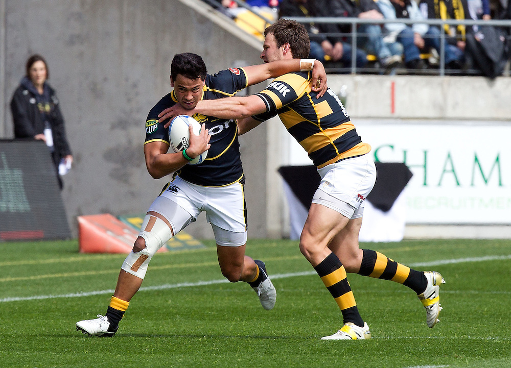 Wellington's Matt Proctor is tackled by Taranaki's Frazier Climo during the Lions vs Taranaki ITM Cup rugby union match at the Westpac Stadium, Wellington, New Zealand, Sunday, October 14, 2012. Credit: SNPA / Marty Melville