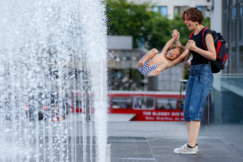 © Licensed to London News Pictures. 08/09/2016. London, UK. Four year-old Rose and her mother enjoys warm weather and sunshine at fountains of Royal Festival Hall in Southbank, London on Thursday, 8 September 2016.  Photo credit: Tolga Akmen/LNP