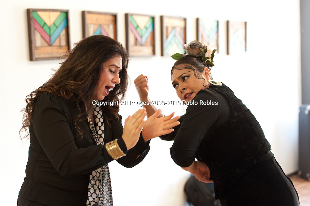 Singer Olivia Rojas (left) and Flamenco dancer Angelina Ramirez (right) during rehearsal in their dance studio in Downtown Phoenix on August 12, 2016. Rojas and Ramirez are co-owners of Flamenco Por La Vida dance studio. Singer Olivia Rojas and Flamenco dancer Angelina Ramirez co-owners of Flamenco Por La Vida dance studio in Downtown Phoenix, AZ.