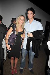 POPPY GRANT and OLIVER HADDEN-PATON at the launch party of the new Embargo 59 nightclub at 533 Kings Road, London on 25th June 2009.