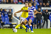 Birmingham City forward Álvaro Giménez (24) challenged by Reading midfielder Andy Rinomhota (8) during the EFL Sky Bet Championship match between Reading and Birmingham City at the Madejski Stadium, Reading, England on 7 December 2019.