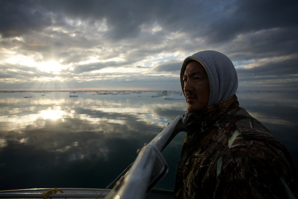 BARROW, AK - 2013: Joe Sage searching for seals on the coast of Barrow, Alaska.