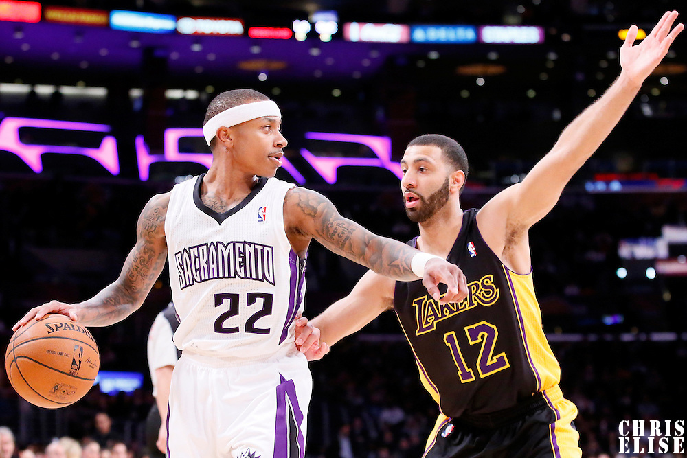 28 February 2014: Los Angeles Lakers point guard Kendall Marshall (12) defends on Sacramento Kings point guard Isaiah Thomas (22) during the Los Angeles Lakers 126-122 victory over the Sacramento Kings at the Staples Center, Los Angeles, California, USA.