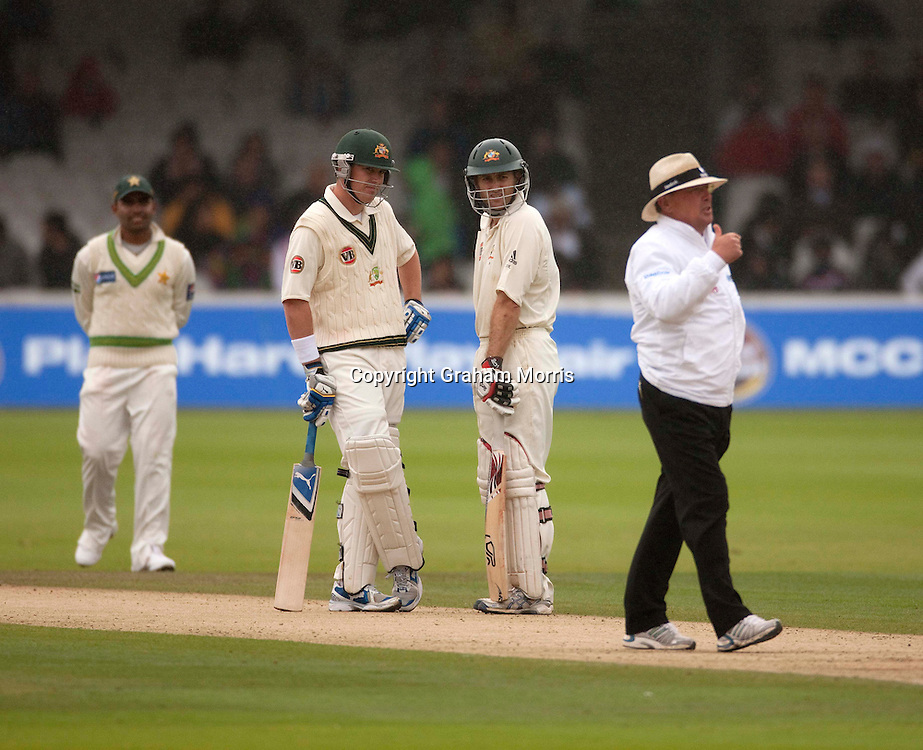 Simon Katich and Marcus North (left) watch as umpire Ian Gould pauses play for bad light and rain during the MCC Spirit of Cricket Test Match between Pakistan and Australia at Lord's.  Photo: Graham Morris (Tel: +44(0)20 8969 4192 Email: sales@cricketpix.com) 15/07/10