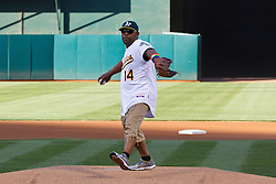 OAKLAND, CA - JUNE 17:  Sidney Burke, brother of former player Glenn Burke, throws out the first pitch before the game between the Oakland Athletics and the San Diego Padres at O.co Coliseum on June 17, 2015 in Oakland, California. The Oakland Athletics defeated the San Diego Padres 16-2. (Photo by Jason O. Watson/Getty Images) *** Local Caption *** Sidney Burke