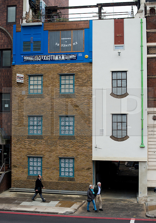 © Licensed to London News Pictures.04/13/2013. London, UK. General view of the Upside Down House on Blackfairs Road, London. London-based artist Alex Chinneck has taken a building on Blackfriars Road, due for demolition, and turned its façade upside down with a design that considers and celebrates the history and life of the building.Photo credit : Peter Kollanyi/LNP