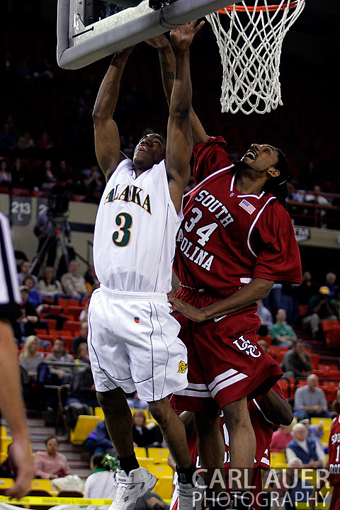 24 November 2005:Junior forward Renaldo Balkman (34) from the University of South Carolina blocks a shot by University of Alaska - Anchorage senior guard Kemmy Burgess (3) in the Gamecock's 65 - 60 victory over the University of Alaska Anchorage Seawolves in the first round of the Great Alaska Shootout at the Sullivan Arena in Anchorage Alaska.