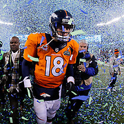 Denver Broncos quarterback Peyton Manning (18) walks off the field after the NFL Super Bowl XLVIII game against the Seattle Seahawks on Sunday, Feb. 2, 2014 in East Rutherford, N.J. The Seahawks won 43-8. (AP Photo/Ric Tapia)