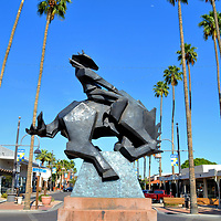 Jack Knife Sculpture in Scottsdale, Arizona<br /> Scottsdale&rsquo;s motto is &ldquo;The West&rsquo;s Most Western Town.&rdquo; To reinforce their theme, the city&rsquo;s logo is a cowboy riding a bucking bronco. Artist Ed Mell brought this symbol to life when he created this 8 &frac12; foot tall, bronze sculpture he calls Jack Knife. The artwork was installed at the intersections of Main Street and Marshall way in 1993 in the heart of the Art District.