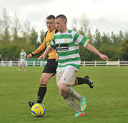 Castlebar Celtic's Ioseph O'Reilly takes on Ballinasloe's Kenneth Kenny Connaught Cup Final.<br /> Pic Conor McKeown