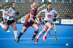 Wimbledon's Nikki Lloyd is chased by Katrina Nicholson of Buckingham. Wimbledon v Buckingham - Investec Women's Hockey League Finals, Lee Valley Hockey & Tennis Centre, London, UK on 23 April 2017. Photo: Simon Parker