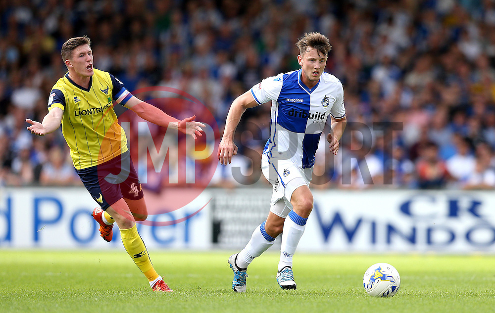 Ollie Clarke of Bristol Rovers runs with the ball past John Lundstram of Oxford United - Mandatory by-line: Robbie Stephenson/JMP - 14/08/2016 - FOOTBALL - Memorial Stadium - Bristol, England - Bristol Rovers v Oxford United - Sky Bet League One