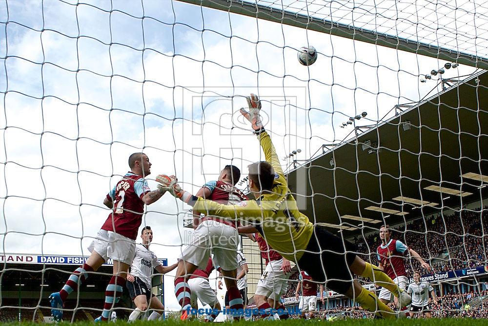 Kieran Trippier of Burnley heads clear over his own crossbar during the Sky Bet Championship match at Turf Moor, Burnley<br /> Picture by Ian Wadkins/Focus Images Ltd +44 7877 568959<br /> 26/04/2014