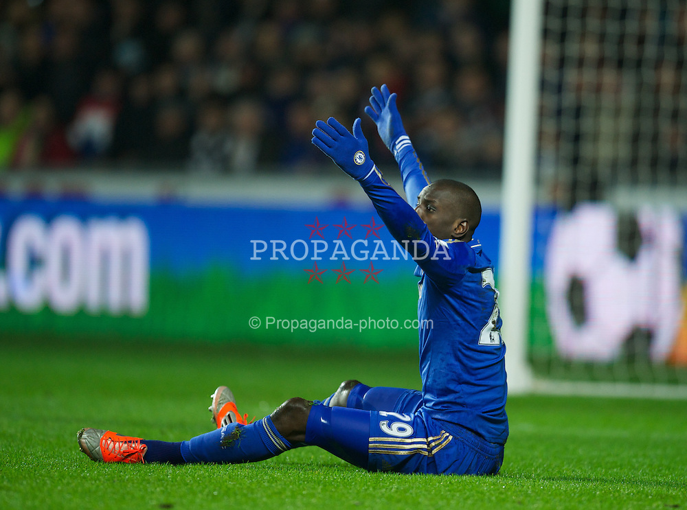 SWANSEA, WALES - Wednesday, January 23, 2013: Chelsea's Demba Ba goes down under a challenge from Swansea City's Ben Davies during the Football League Cup Semi-Final 2nd Leg match at the Liberty Stadium. (Pic by David Rawcliffe/Propaganda)